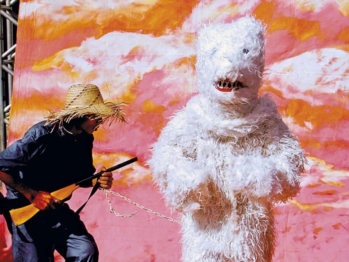 Urso e caçador