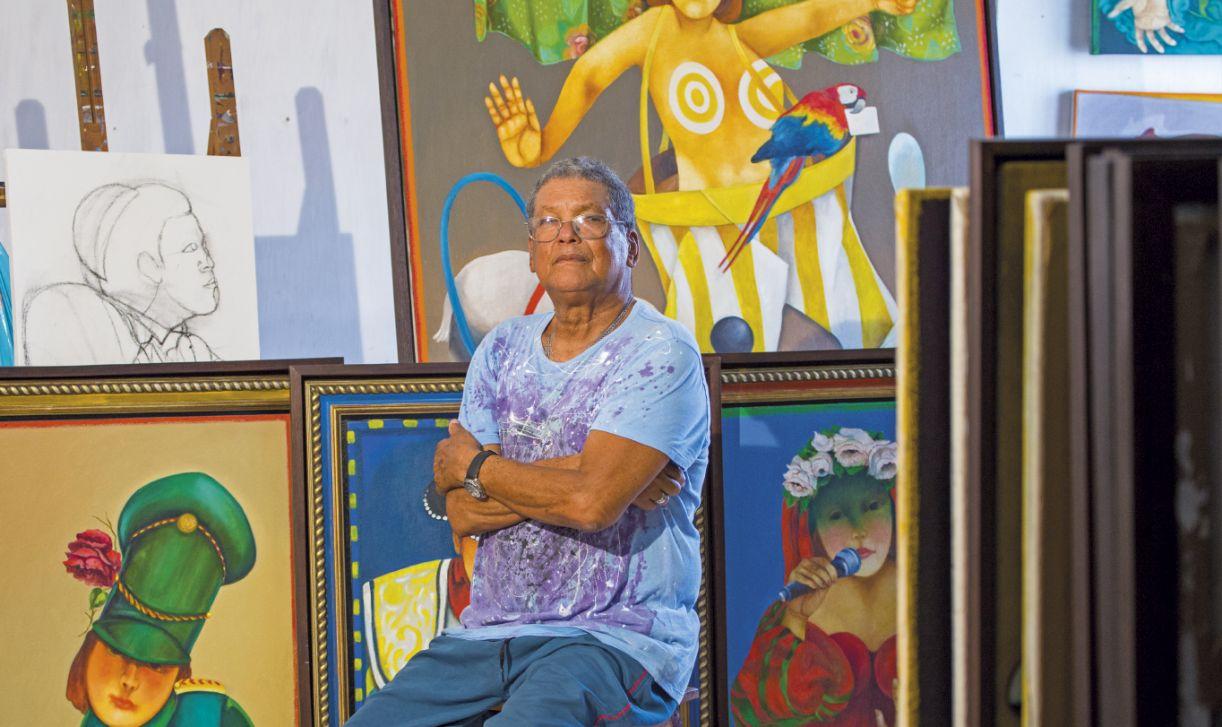 O pintor José de Moura entre as obras de seu livro e exposição inspirados no universo do circo